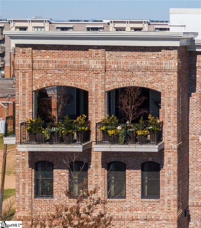 rare two-level corner condo in downtown Greenville mansions