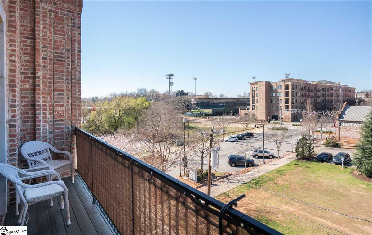 Luxury homes in rare two-level corner condo in downtown Greenville