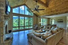 GRAND HOME BOAsts Mountaintown Creek frontage with long-range mountain views mansions