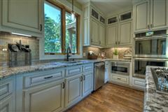 Luxury homes  GRAND HOME BOAsts Mountaintown Creek frontage with long-range mountain views