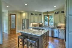 Luxury real estate  GRAND HOME BOAsts Mountaintown Creek frontage with long-range mountain views