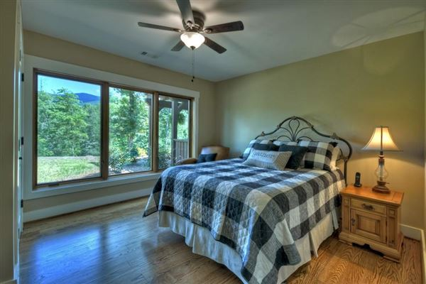 Luxury properties  GRAND HOME BOAsts Mountaintown Creek frontage with long-range mountain views
