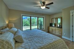 GRAND HOME BOAsts Mountaintown Creek frontage with long-range mountain views luxury properties