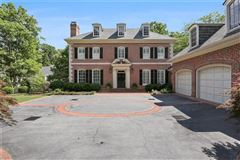 perfectly situated brick home in sought-after Tuxedo Park luxury homes