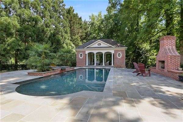 Luxury homes perfectly situated brick home in sought-after Tuxedo Park