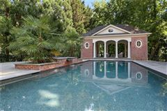 perfectly situated brick home in sought-after Tuxedo Park luxury properties
