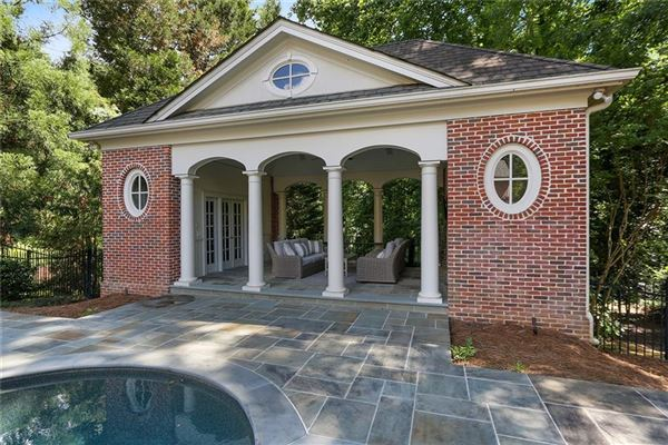 Luxury real estate perfectly situated brick home in sought-after Tuxedo Park