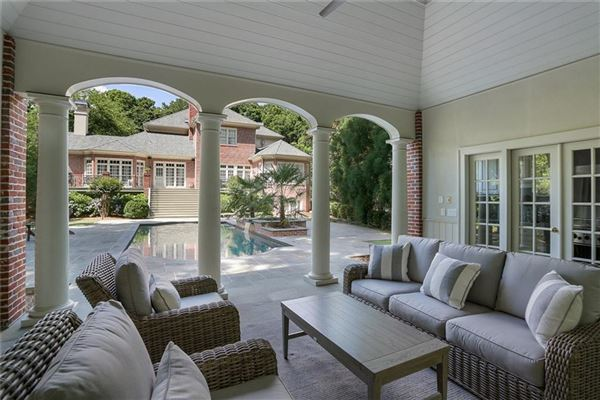 perfectly situated brick home in sought-after Tuxedo Park luxury real estate