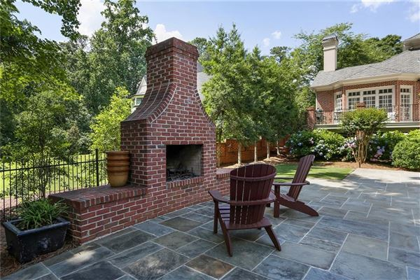 Luxury properties perfectly situated brick home in sought-after Tuxedo Park