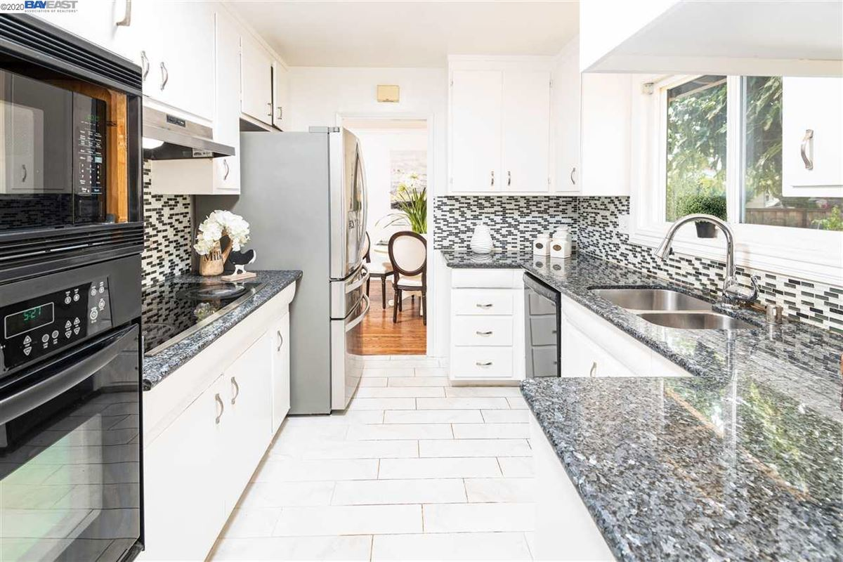 this Extensively remodeled stylish and classy home is on a corner lot luxury homes