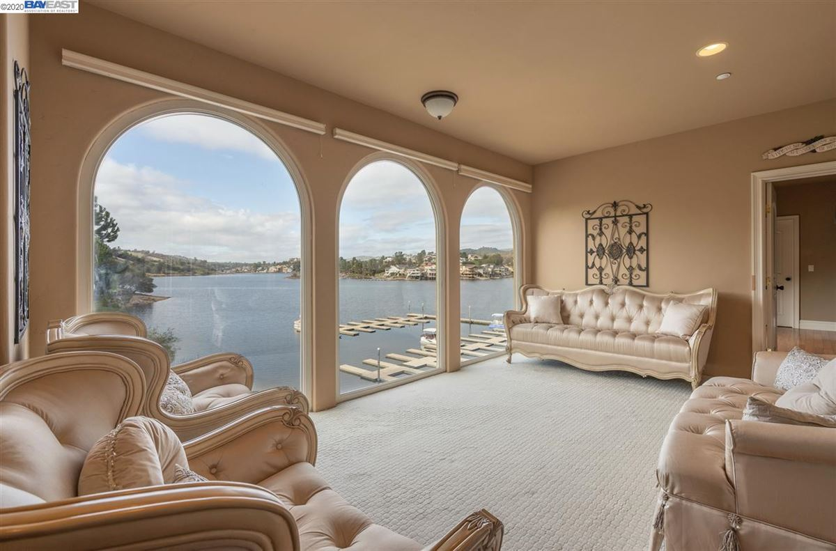 Luxury homes this majestic beauty sits lakefront with views of the water from most rooms