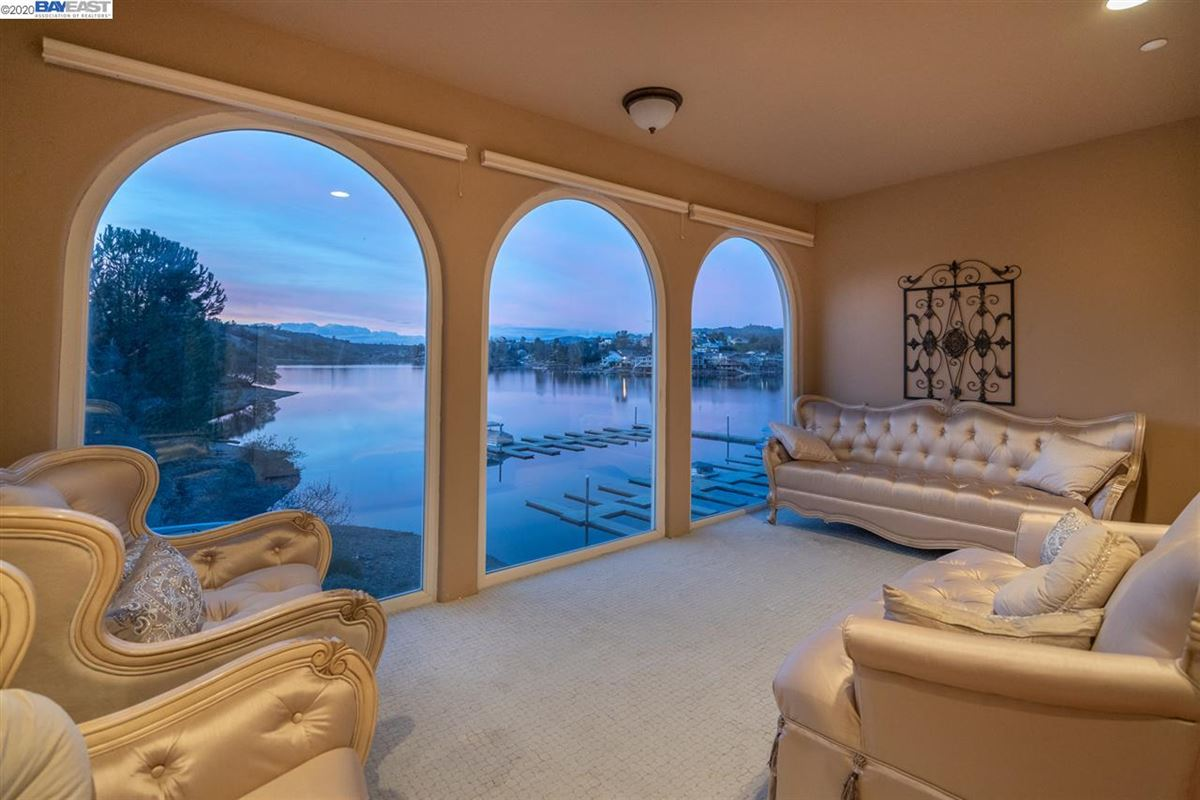 this majestic beauty sits lakefront with views of the water from most rooms luxury homes