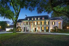 Mansions in grand colonial overlooking country club golf course