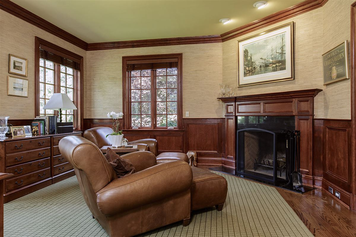 Luxury properties classic Woodcrest stone and shingle Colonial