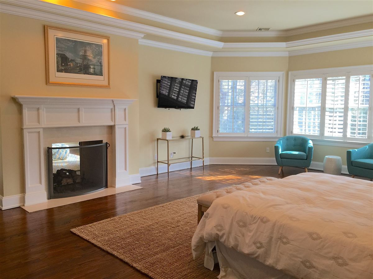 classic Woodcrest stone and shingle Colonial luxury properties