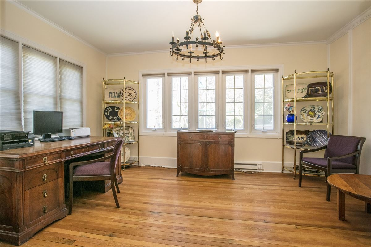 Luxury homes grand and sun-filled Center Hall Colonial