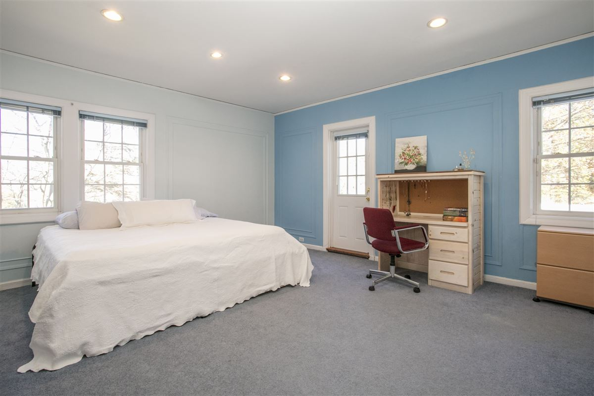 Luxury homes in grand and sun-filled Center Hall Colonial