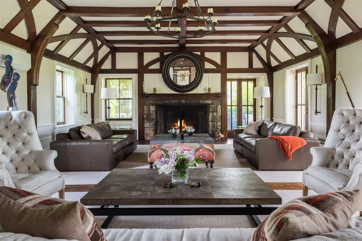 Luxury real estate renovated vintage stone manor and guest house on 17-plus acres