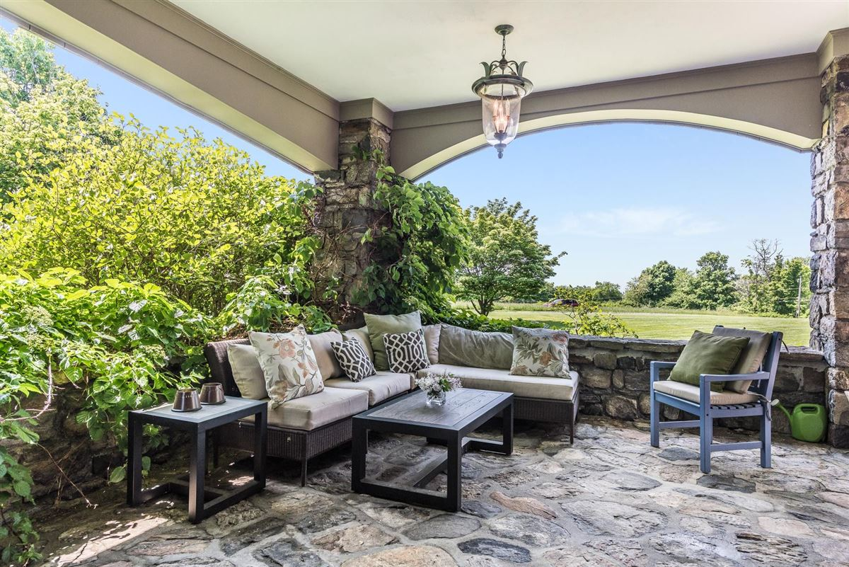 Luxury properties renovated vintage stone manor and guest house on 17-plus acres