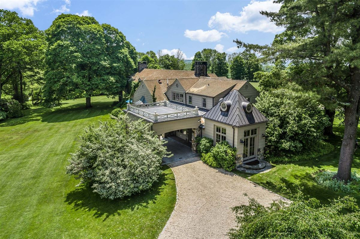 Luxury homes in renovated vintage stone manor and guest house on 17-plus acres