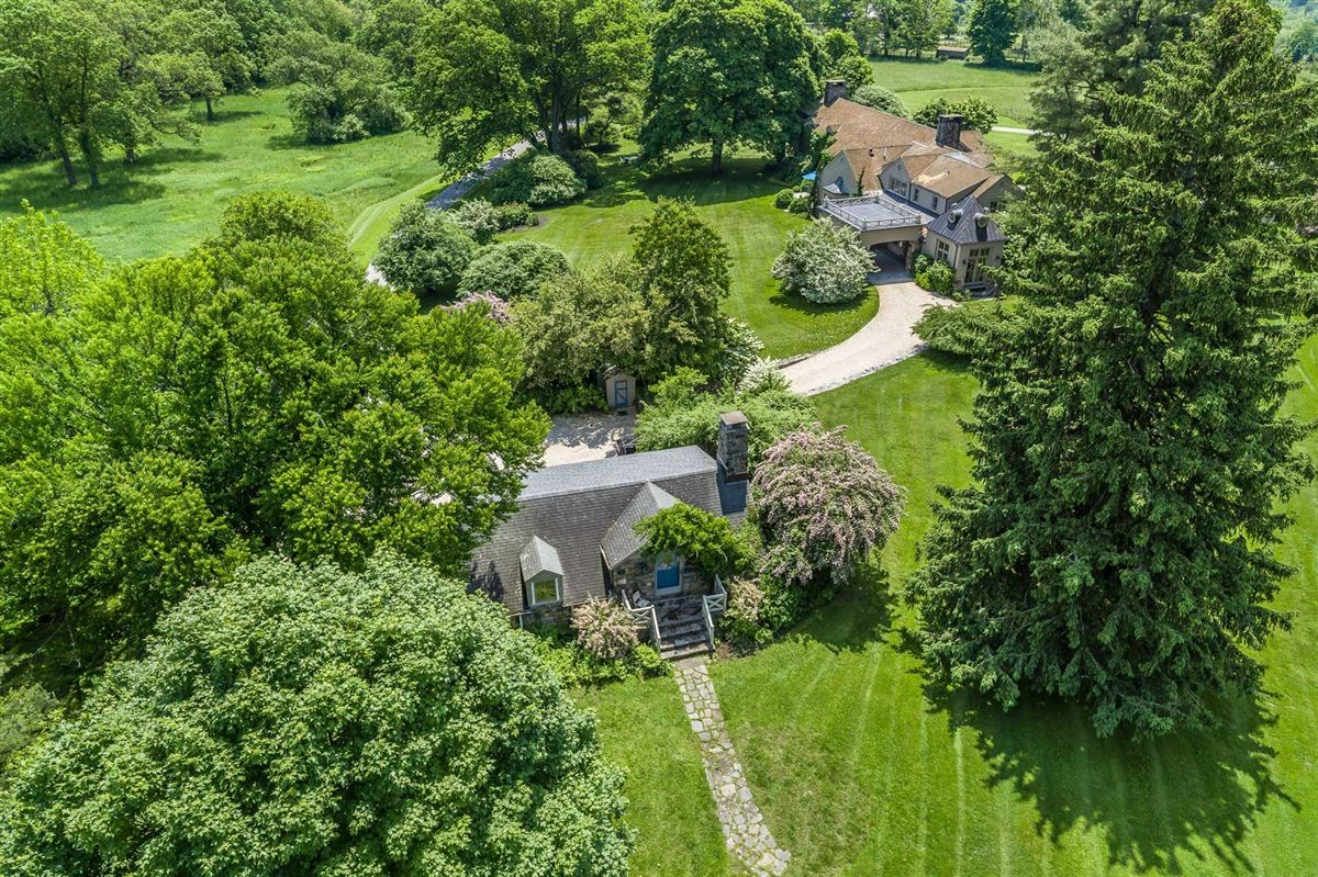 Mansions in renovated vintage stone manor and guest house on 17-plus acres