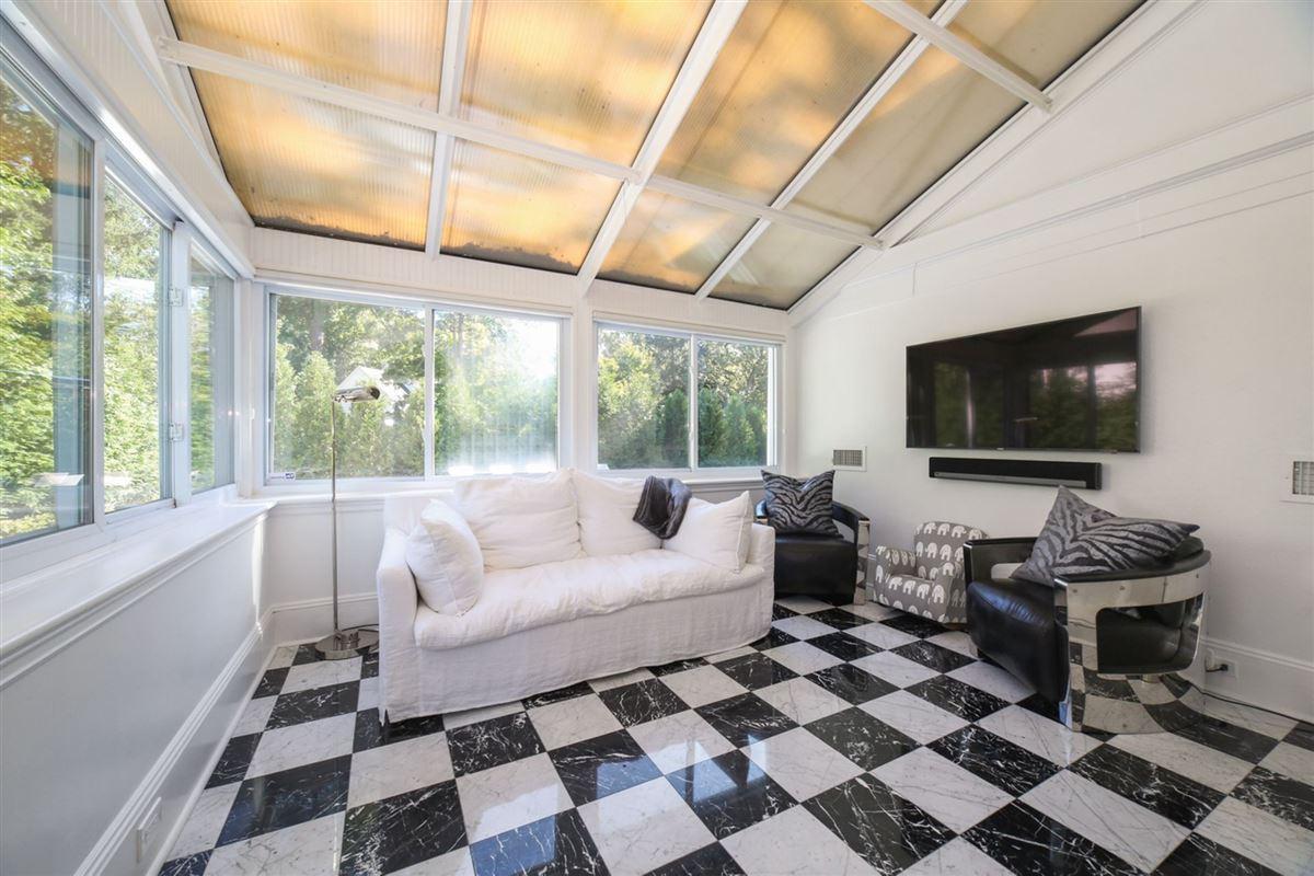 an exquisite Mediterranean in Beechmont Estates luxury real estate