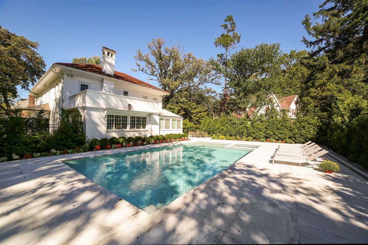 an exquisite Mediterranean in Beechmont Estates mansions