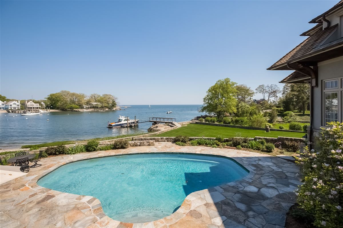 Lounge By The Pool In This High-End Home In Darien luxury homes