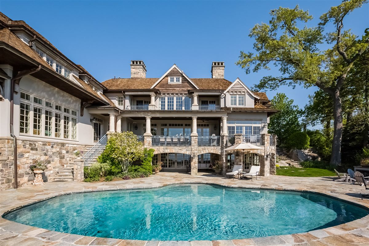 Luxury real estate Lounge By The Pool In This High-End Home In Darien