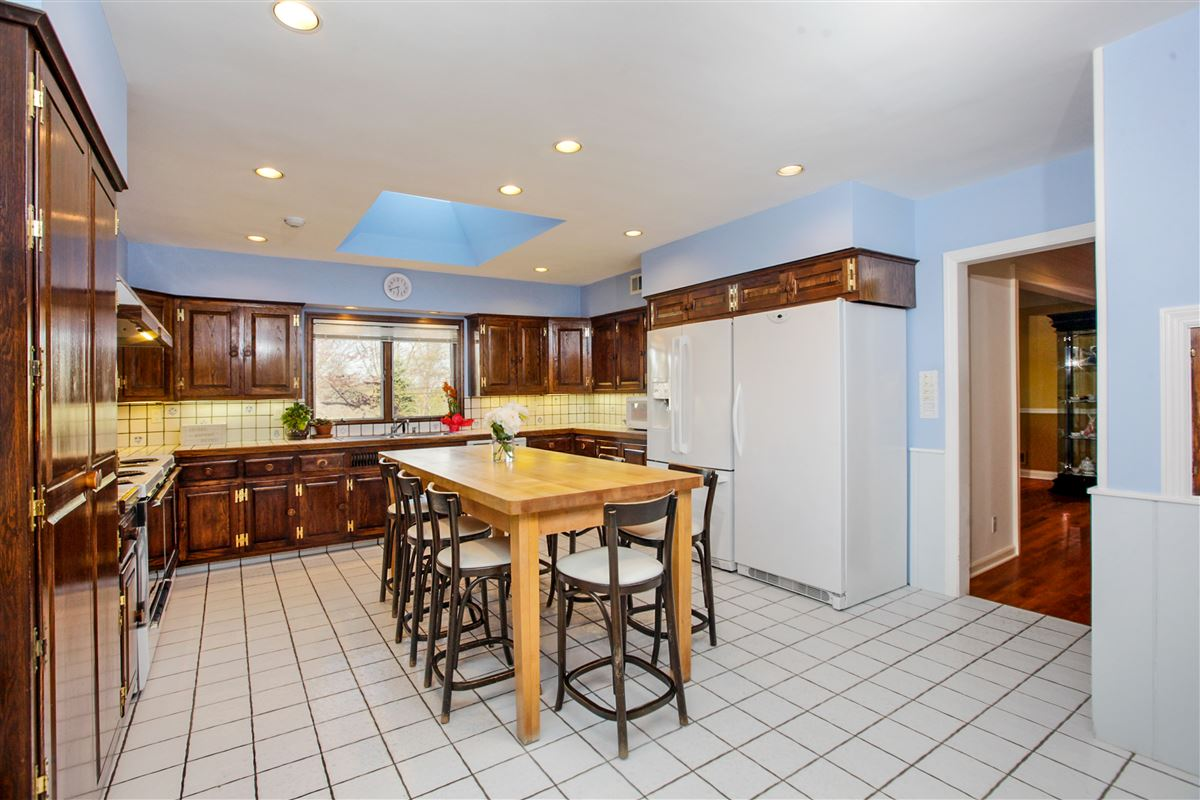 Lovingly maintained spacious sun drenched home luxury real estate