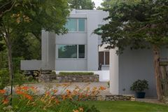 modern architectural masterpiece atop 25 acres mansions