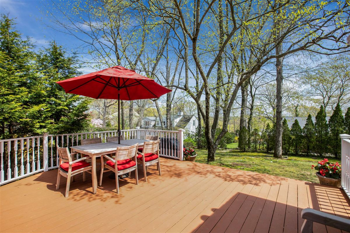 Stylish and renovated home offers a deck and backyard luxury real estate