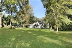 Coveted mid-country colonial in greenwich luxury properties