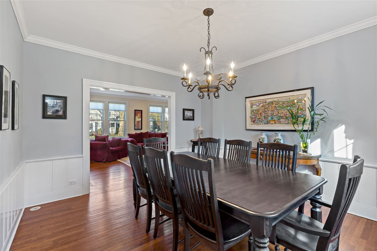 Luxury real estate sunny Colonial on a tree-lined street