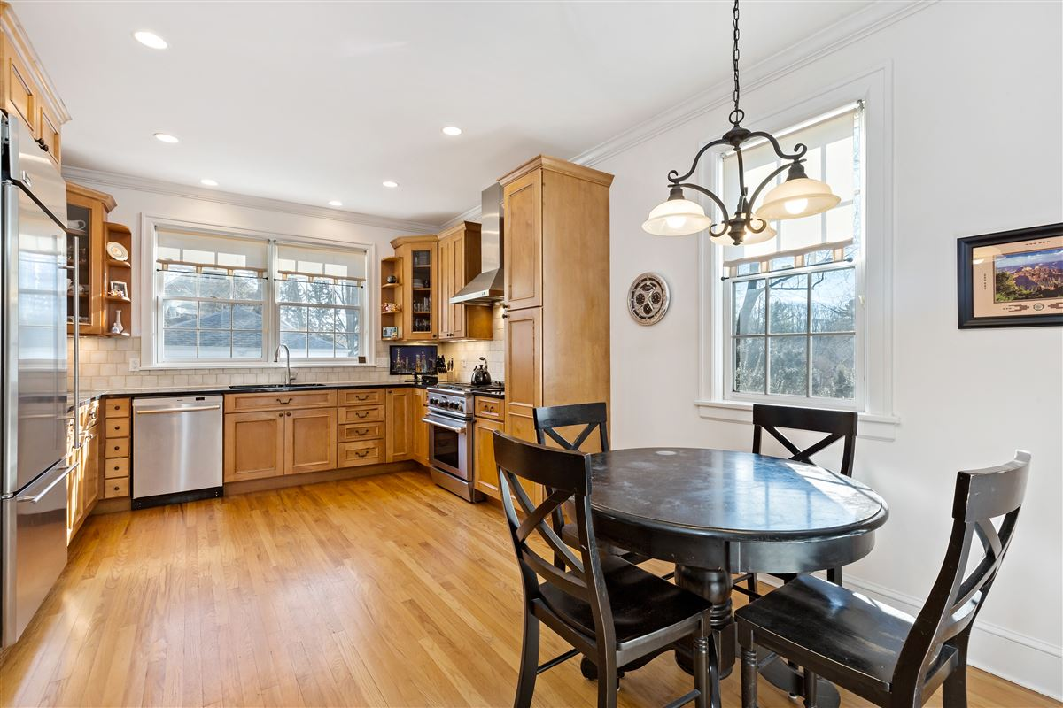 sunny Colonial on a tree-lined street luxury real estate