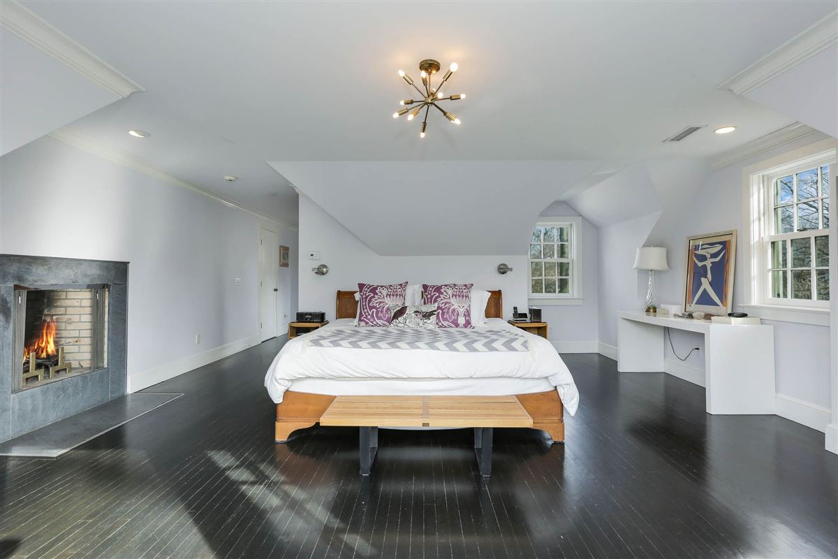 Luxury real estate stunning four-bedroom Cape set on .35 level acres