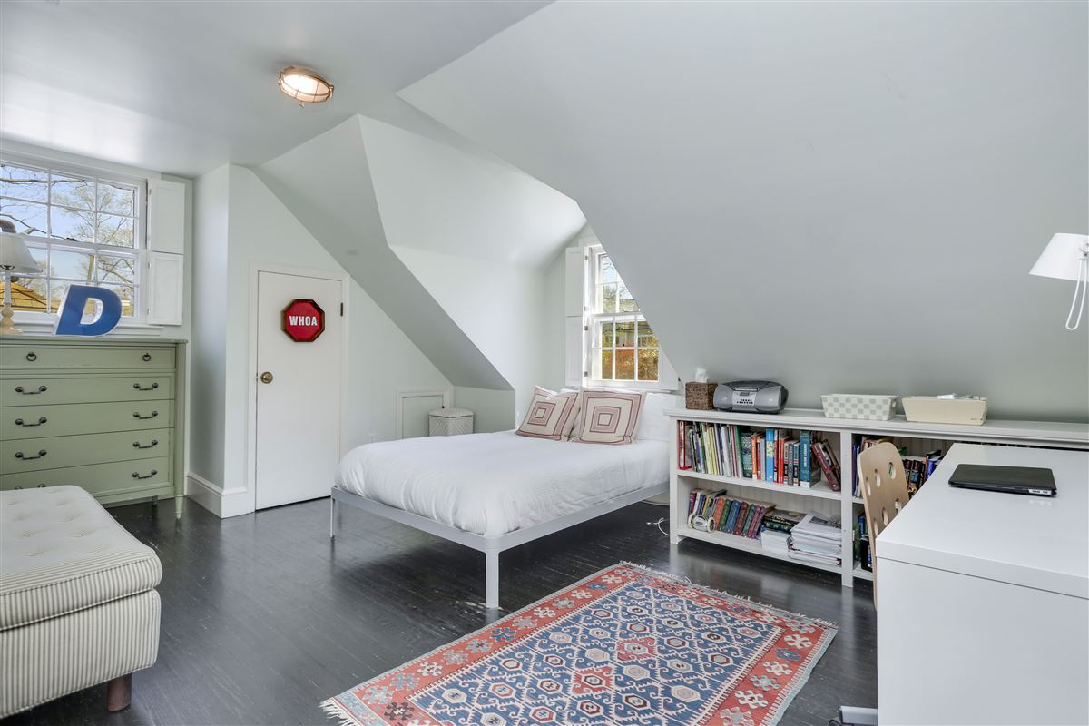 stunning four-bedroom Cape set on .35 level acres luxury properties