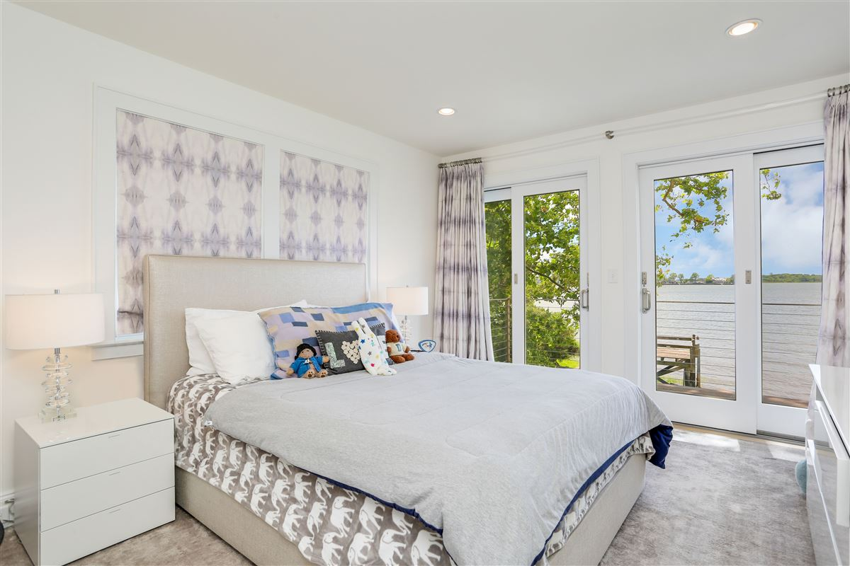 updated five-bedroom waterfront home luxury homes
