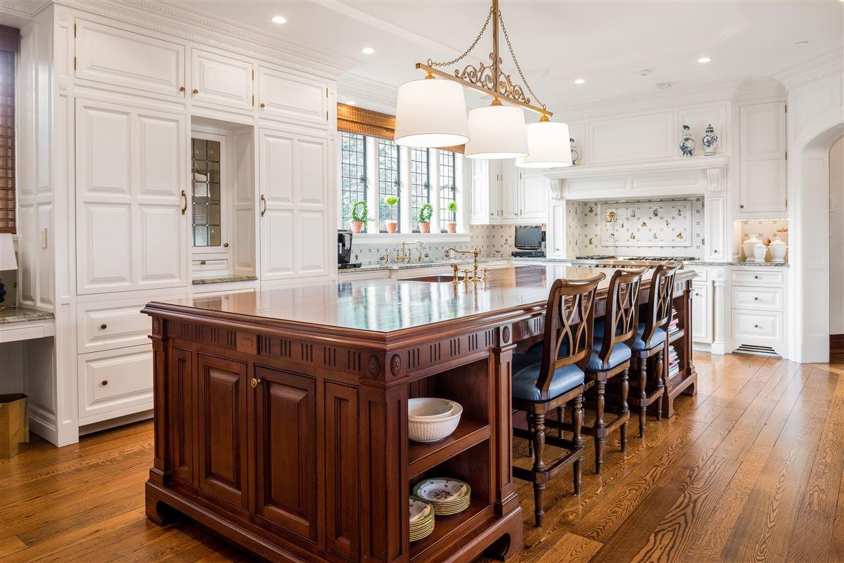Luxury properties updated Cotswold Tudor Revival in New York