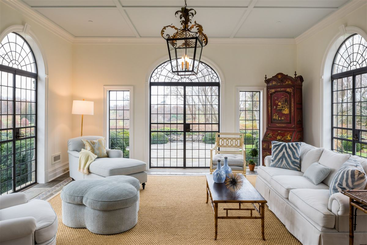 Mansions updated Cotswold Tudor Revival in New York