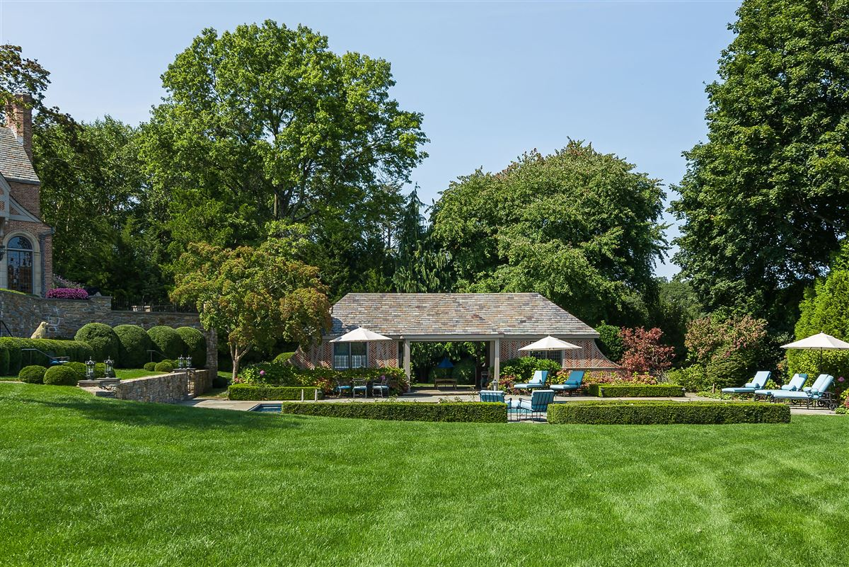 Mansions in updated Cotswold Tudor Revival in New York