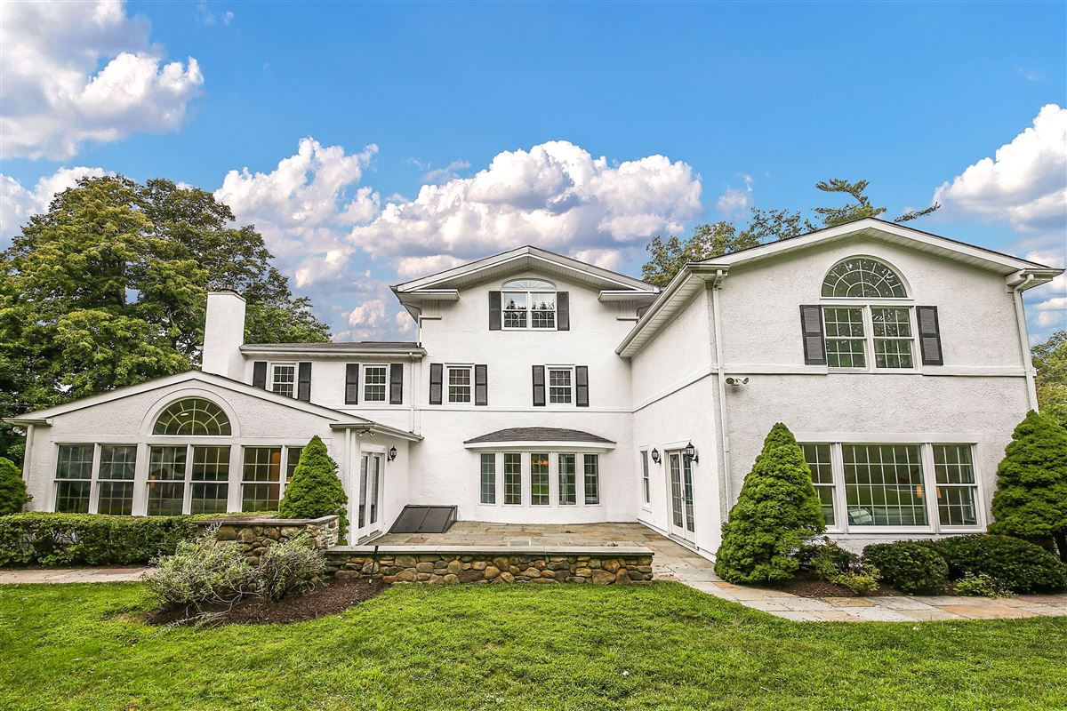Luxury homes in Picture Perfect Colonial on lush property