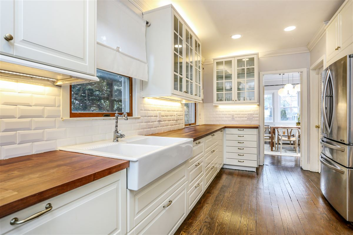 Tastefully renovated and pristine center hall Colonial luxury properties