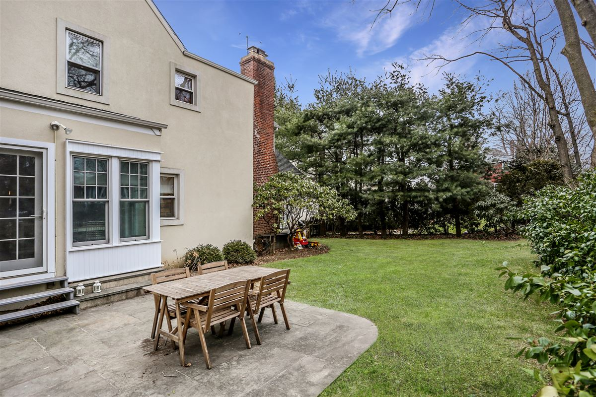 Tastefully renovated and pristine center hall Colonial mansions