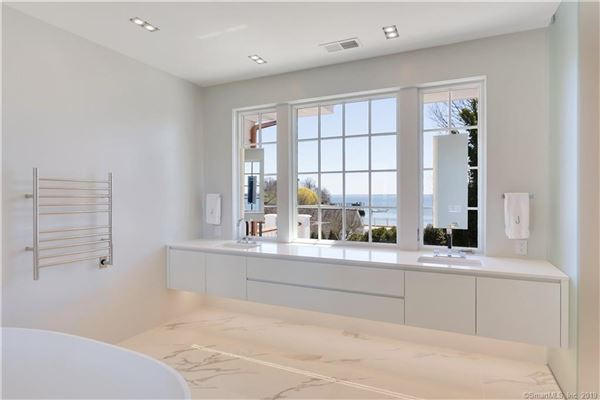 new home in Belle Haven with water views mansions