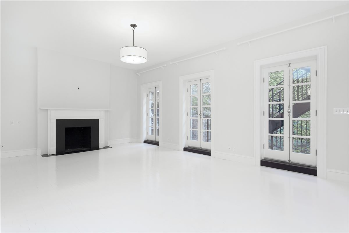 Luxury properties four-story Federal style brick townhouse