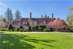 Exceptional Belle Haven peninsula stone English Manor style mansions