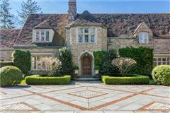 Mansions in Exceptional Belle Haven peninsula stone English Manor style
