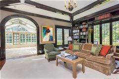 Luxury homes in Exceptional Belle Haven peninsula stone English Manor style