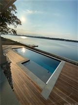 Dramatic newly constructed direct waterfront home luxury real estate